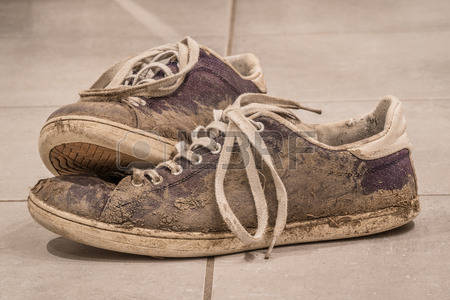 54123650-dirty-shoes-with-mud-and-soil-on-a-floor